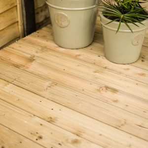 Close Up Of Decking With Plants & Pots